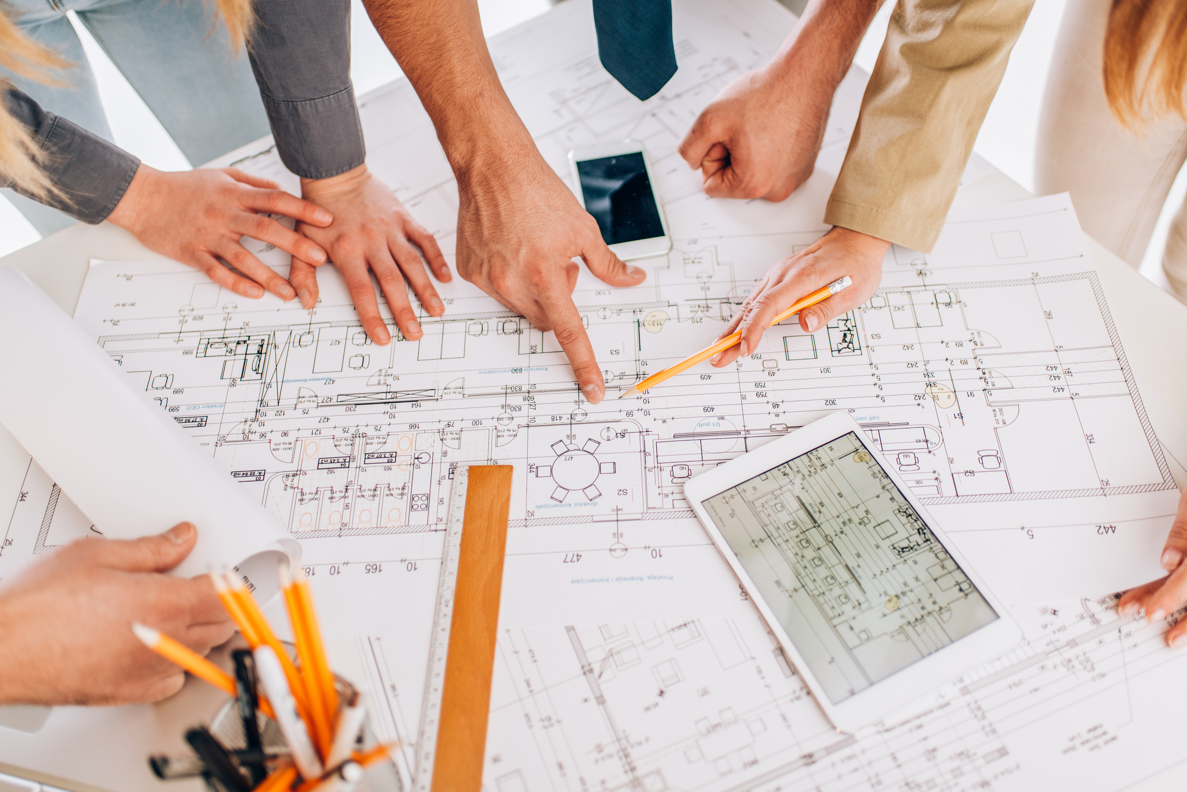 hands pointing at a project